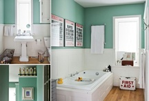 """My aqua-colored oasis / First floor bathroom... The double bowl vanity top says """"his and hers"""" but the display apothecary jars, color-matched cotton swabs, and bubble bath accoutrements scream, """"Don't use the guest towels, damnit!"""" / by Christine Pasono"""