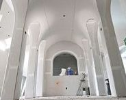 Igloo Ceilings / The igloo ceiling is similar in design to the groin vault, but it has one distinct difference.  The groin vault is made by intersecting two barrel vaults at the same height, while igloo ceilings intersect barrel vaults, or archways, at different heights.  In other words, an igloo ceiling uses two or more different intersecting heights while a groin vault intersects at the same height.  It sounds small in theory, but in practice, it makes a vast difference.
