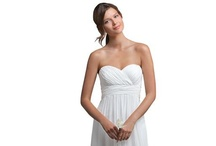 Beach Wedding Dresses / A beach wedding gown needs to be airy and light. Find your perfect wedding dress for your ceremony on the sand during your destination wedding.