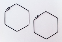 """{ HEXAGON } / In geometry, a hexagon (from Greek ἕξ hex, """"six"""") is a polygon with six edges and six vertices. A regular hexagon has Schläfli symbol {6}. The total of the internal angles of any hexagon is 720°."""