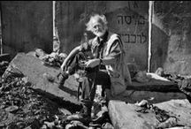 Josef Koudelka / Josef Koudelka (born January 10, 1938) is a Czech photographer in Magnum Photos since 1971. Throughout the 1970s and 1980s, Koudelka sustained his work and continued to exhibit and publish major projects like Gypsies (1975) and Exiles (1988). Since 1986, he has worked with a panoramic camera and issued a compilation of these photographs in his book Chaos in 1999. Koudelka has had more than a dozen books of his work published, including most recently in 2006 the retrospective volume Koudelka.