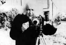 Mario Giacomelli / Mario Giacomelli (1925 – 2000) was an Italian self-taught photographer. One of Giacomelli's most iconic images, Scanno Boy (1957) consists of a picture portraying a group of women walking towards the observer with only one single and central object in focus: a boy walking with his hands in his pockets. Apart from Scanno, Giacomelli's most successful series are The Landscapes (1954-2000) and I Pretini  (1961-1963), a transcription of the everyday life of a group of young priests.