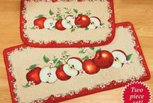 Apple Kitchen / MMMM... There's nothing like the taste of a fresh, crisp apple.  And nothing more fun than the classic look of red & green apples in the Kitchen.  This popular decorating theme works beautifully for your Home year round, no matter where you live.  If we had our way, we'd put apples on everything and in everything too!