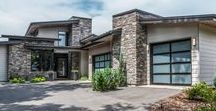Columbine Circle / Modern Denver Infill stone and siding contemporary home with glass garage doors.