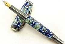 """Polymer Clay Pens / Tina uses Polymer Clay to create these """"one of a kind"""" patterns as seen below in any pen style that we have available. The Polymer Clay blanks are baked, sanded, and sealed with a durable, long lasting finish, so there is no extra care needed to enjoy this unique material. These original blanks are offered in only one pen per design to provide exclusive ownership for you or your favorite pen collector."""