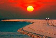 Sunsets Around The World With Brooklyn Travel Agency / Experience sunsets in all kinds of exotic places with the experts at Brooklyn travel agency, Do-All Travel!