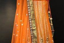 Orange, peach, & coral decor / Orange decor orange flowers, table settings for any Indian or Pakistani wedding.  Find more information at www.Shaadi-Bazaar.com
