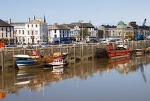 """BIDEFORD, NORTH DEVON / Picturesque Bideford, historic port from which Raleigh & Grenville sailed, is on the River Torridge in North Devon, about 14 miles (25 mins drive) from us.  Became Britain's third largest port in the Sixteenth Century.  Raleigh landed his first shipment of tobacco here.  Described by local writer, Charles Kingsley of """"The Water Babies"""" fame as the """"little white town"""".  Biddeford, Maine USA (old spelling) & Bideford in Prince Edward Island Province, Canada are named after this town."""