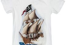 Kids Love Pirates / Pirate ships, eye patches, pirate shirts and lots of parrots. What's there not to love about a pirate-themed room or a pirate party. Kids love pirates and here you will find pirate crafts, activities and decorations - and of course pirate shirts.