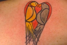 PARROT, BIRD & FEATHER TATTOOS / These are not my tattoos & I do not own the rights to these wonderful pictures I have collected. Mine is the one of Louie & Libby in a heart but maybe I'll add some of these? / by Mimi Grzymala