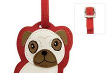 Love Your Breed - Luggage Tags / FouFou Dog wants you to travel in style! These luggage tags are a must have for any pet lover! There is no better way to remind yourself of the sweetness of home than an adorable breed-specific tag to attach to your luggage. Dress your bags and differentiate yours from all the rest with these stylish tags. Put it on everything from your luggage, to your purse, or even your gym bag! Inside each tag, you will find a standard address card for you to fill out. Available in over 30 breeds!