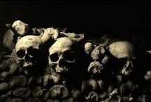 """Catacombs of Paris / The Catacombs of Paris or Catacombes de Paris are underground ossuarys in Paris, France. Located south of the former city gate (the """"Barrière d'Enfer"""" at today's Place Denfert-Rochereau), the ossuary holds the remains of about six million people."""