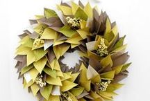 Paper & Felt Wreath Ideas / Whether your wreaths are made from paper bags, coffee filters, tissue paper or felt, these wreaths will brighten your home any day! http://bit.ly/papermaterialswreaths