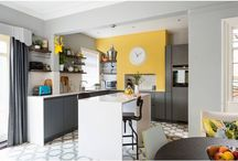 Handle-less Dark grey Kitchen. / A sleek modern kitchen mixed up with traditional elements and features.  Here is a great example of how you can mix up styles: a dark grey Beeck German handle-less kitchen, with minimal White Storm Silestone quartz worktops is then paired up with bright mustard yellow painted walls, a Vinyl floor with a bold geometric design, and reclaimed scaffolding boards act as open shelving on the walls.
