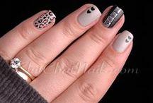 Fingers. / Nail polish and rings.