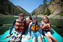 Idaho Travel / Idaho is filled with scenic wonders for you to explore. There are fairs and festivals that welcome you to taste the flavor of Idaho's communities.  Whitewater recreational rivers and clear water lakes abound and beckon you to enjoy fly-fishing or engage in adventurous rafting.