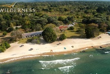 Chintheche Inn - Malawi - Wilderness Safaris / Chintheche Inn is set on the western shores of central Lake Malawi. The pristine sandy beaches curve endlessly away to the horizon - palm-fringed, dotted by fishing villages and patches of lowland tropical forest. It's no wonder that Chintheche Inn is located in what is considered to be the most verdant region of Malawi.