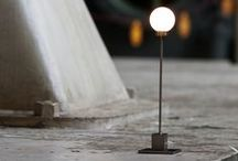 """Snowball / Snowball is a clean–edged lamp in a functional style, with a slim stem supporting a solid mouth blown glass globe the size of a snowball. The lamp is constructed in metal, with a """"snowball"""" shape in frosted glass for a lampshade. Snowball emits an intimate light."""