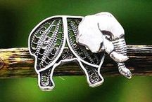 Elegant Elephants / Elephants are considered one of the wisest creatures of the animal kingdom. Their natural elegance, grace and beauty combined with deep mahogany wood, sterling silver trinkets and gleaming gold treasures creates NOVICA's one-of-kind elephant collection.