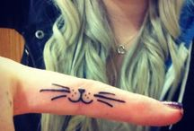Epic Tattoos/Piercings / Cool, not necessarily getting them, but cool  / by Emily Gray