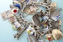 Vintage Travel Charm Bracelets / I simply can't resist any charm with a travel theme. Travel shield shields are my favorite and I like to add enamel map charms, 3D Building charms and vintage silver charms that depict places around the world.    zyzzy