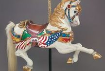 Carousels & Carousel Animals / These beautiful painted ponies & other animals have captivated me since I was a child.  I have collected miniatures of them and one day would love to have a real life-size carousel pony in my home.  As a child, carousels were my most favorite ride at carnivals and amusement parks.   / by Patti Elliott Di Loreto