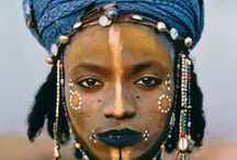 Indigenous People / Also called Indigenous Peoples, Tribal Peoples and First Peoples.   Usually have their own language, their own land and distinctive cultural traditions that are still practiced.