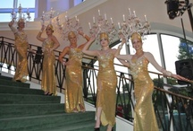 promotional models-events planning / Chandeliers Dancers.  There is no better way to wow your guests, with Our beautiful Crystal Chandelier Dancers could appear anywhere in the room and start performing choreography with lighted crystal Chandeliers on the top of their heads! They could create  an aura of elegance as they drifted about serving cigars, Champagne or just dancing with the guests.#EventsPlanning #Models #PromotionalModels
