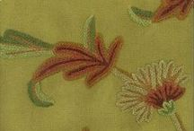 Crewel Fabric / Crewel fabrics are embroidered fabrics. Usually wool. A great classic pattern.