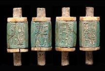 """Ancient Cylinder Seals, Stamp Seals, Signet Ring And Clay Tablets B.C.E. /  Ancient cylinder seals allowed information to be communicated on clay tablets, without the laborious act of incising or drawing.  With a handheld seal, mud or clay plugs could be marked and applied more quickly on merchandise for sale and trade. Storage jars and containers for trade were more easily labeled and in some cases priced. Signet rings of the wealthy were private """"signatures"""" to show ownership, among other uses.  / by Violet Shimer Love"""