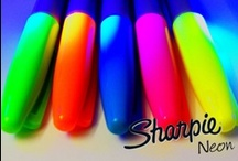 Start bright. GO ELECTRIC.  / Bright in daylight. Bright under black light. New Sharpie NEON markers will have you shining bright and bold no matter the hour.