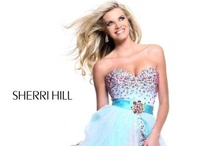 2013 Sherri Hill Short  / Immediately embraced by style and trendsetters worldwide Sherri Hill Short designs can be found in the wardrobes of Hollywood stars and fashion influencers as well as on the pages of the top fashion publications worldwide. Sherri Hill Short has also defined her cinematic and television fashion sense of style through her work and design collaborations with some of today's most influential movie and television stylists.