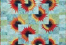 Sunflower Illusions / For more information about the Sunflower Illusions pattern, visit http://www.quiltworx.com/patterns/sunflower-illusions/. To be taken directly back to this pattern page on Quiltworx.com, simply click on any of the images below.  / by Quiltworx Judy Niemeyer