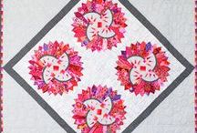 Quiltworx Dresden Plate / For more information about the Quiltworx Dresden Plate pattern, visit http://www.quiltworx.com/patterns/quiltworx-dresden-plate/. To be taken directly back to this pattern page on Quiltworx.com, simply click on any of the images below. / by Quiltworx Judy Niemeyer