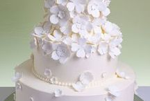 White Wedding Cakes / Featuring wedding cakes that are tone-on-tone white or ivory. Some may have a small spot of color, as well, and some may be accented in silver or gold. We also have boards for cakes with color, wedding cupcakes and mini wedding cakes. Enjoy!