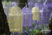 Handmade Paper Birdcage Lanterns & Wedding Decor / Lovingly handmade by us from the finest UK milled papers which are FSC certified & from managed forests.  Birdcages are available in 7 colours & 3 sizes (28-50cm high). Our studio also offers bespoke colours, where you can select from 50 colours to match your theme.  Each lantern includes a wire-free, battery powered Buttonlite, which can be switched on/off to illuminate the lantern, casting beautiful shadows & to create a romantic ambience.