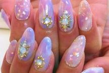 Long, hard and covered in rhinestones / Nail art will never die.  / by Kat Saunt