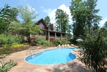 Belmont NC Homes for Sale in Misty Waters / Enjoy a gated waterfront community with large lots, beautiful landscaping and a friendly personality! Clubhouse, pool, marina!  Live the resort life all year!