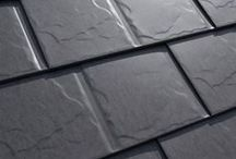 Slate / Interlock® Slate Roofing. The graceful elegance of slate roofing without the weight... Traditional slate is very expensive and is also very heavy;  in fact some rafters may need to be reinforced. With an Interlock® Slate roof you'll get the longevity and look of natural slate roofing without the weight.