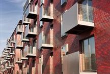 Vantage Quay   Conran and Partners / The Vantage Quay site is part of the Manchester Waterfront masterplan commissioned by Town Centre Securities to regenerate the Piccadilly Basin area of Manchester. The scheme comprises 117 studio, one and two bedroom apartments, basement car parking and a residents' garden. The building is a brick volume wrapped on its two waterfront elevations by a lightweight timber screen.