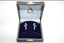 Diamond Earrings / Accent your style with a stunning pair of Diamond Earrings.  Allurez Jewelers offers a wide selection of Dangling Earrings, Studs, Drops, Hoops, and Earring Jackets.  You may even choose to design your own stud earrings! www.Allurez.com   / by Allurez