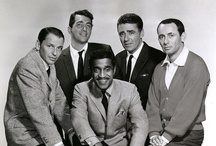 "The Rat Pack & Friends / The Rat Pack was a group of actors originally centered on Humphrey Bogart. In the mid-1960s it was the name used by the press and the general public to refer to a later variation of the group, after Bogart's death, that called itself ""the summit"" or ""the clan,"" featuring Frank Sinatra, Dean Martin, Sammy Davis, Jr., Peter Lawford, and Joey Bishop, who appeared together on stage and in films in the early-1960s, including the movie Ocean's 11. 