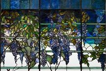 Louis Comfort Tiffany / A celebration of the work of Louis Comfort Tiffany, key artist in the American Art Nouveau movement, he designed stained glass windows and lamps, glass mosaics, blown glass, ceramics, jewellery, enamels and metalwork.