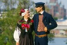 Folk costumes, folkdräkter, kansallispukuja. / Folk costumes - mainly from Finland. Traditional garments to be worn during festivities.