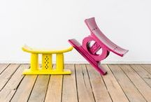 African stools / African geometric designs and a splash of bright coloured paint on wooden stools...
