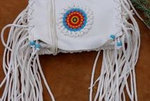 Beaded leather handbags / We have a line of beaded handbags with many different sizes and styles.