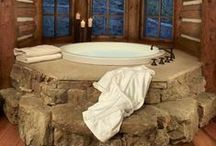 Home // Bathrooms / Round tubs, enclosed tubs, fireplace tubs, shower lights, glass doors, stone floors, I could go on!