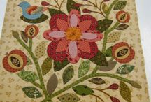Quilts ~ Appliqué / A style of quilting that is uniquely intended as an expression of art and creativity. While quilts have evolved as a creative way to create a utilitarian item, the introduction of appliqué is purely intended as decoration.