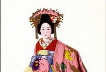"""Japan ~ Oiran / Oiran (aka Tayuu) were courtesans in Japan. The oiran were considered a type of yūjo  """"woman of pleasure"""" or prostitute. However, they are distinguished from ordinary yūjo in that they were entertainers, and many became celebrities outside the pleasure districts. Their art and fashions often set trends and, because of this, cultural aspects of oiran traditions continue to be preserved to this day. In addition to the elaborate hair style, the obi is tied in the front."""