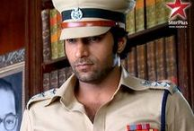 Arjun / Arjun is about a rebellious cop with an attitude, Arjun Raute. He becomes a part of Emergency Task Force (ETF) and solves mysterious crime investigative cases, which no one else can. But he doesn't hesitate to break any rules of the system and only believes in solving the crimes and helping the victims or affected families.
